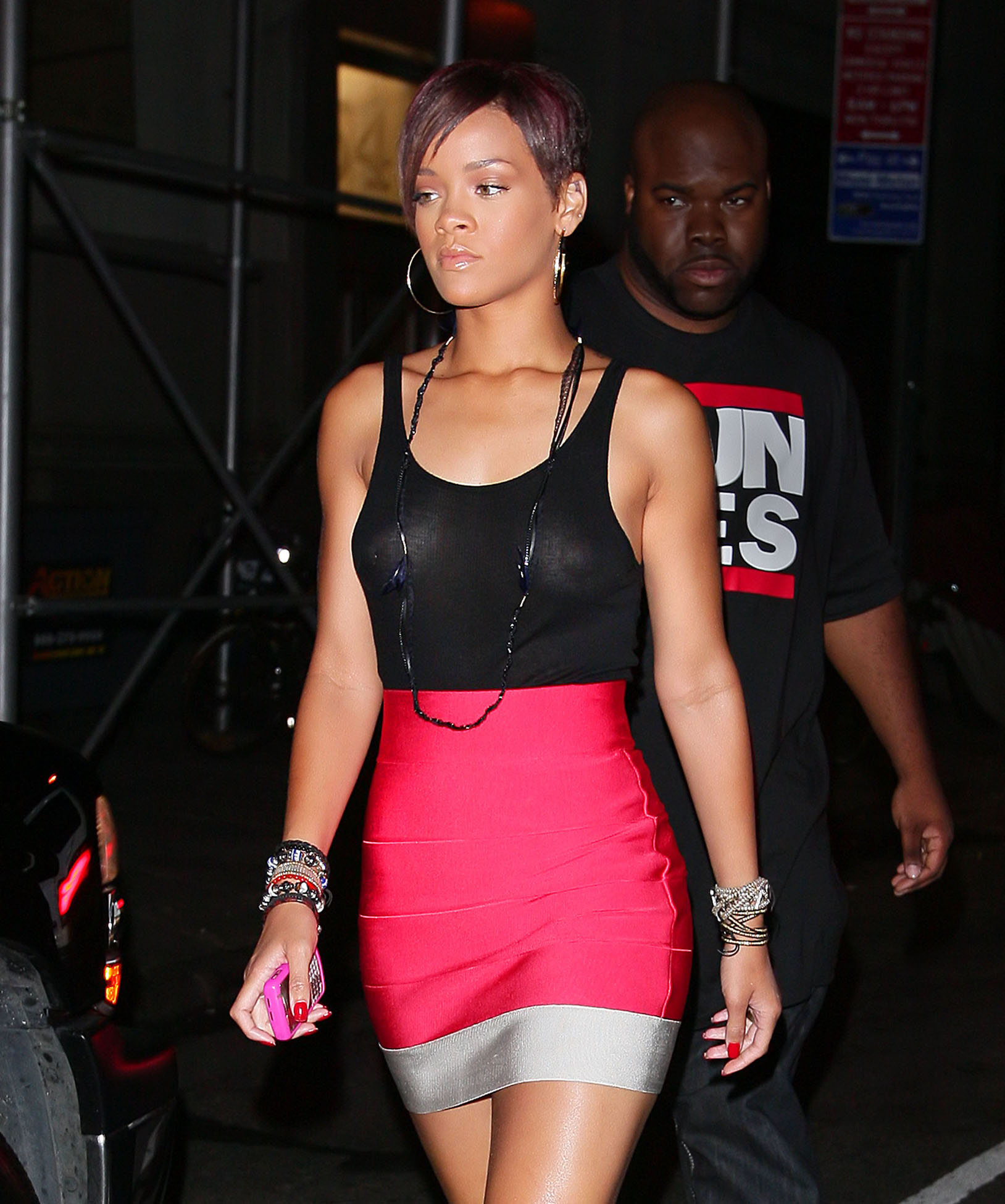 Rihanna looks red hot in a see-through top exposing her nipples and ...